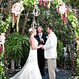 Ceremony under the floral arbor