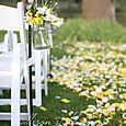 Mason jars filled with flowers line the aisle