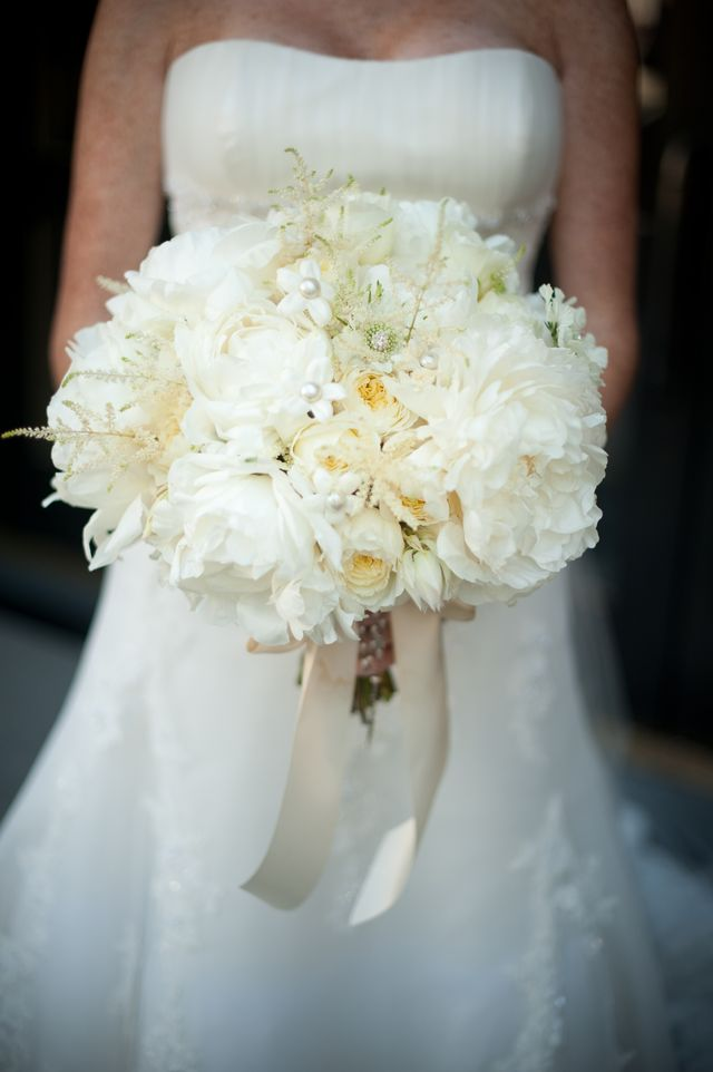 All white bridal bouquet with peonies and cabbage roses