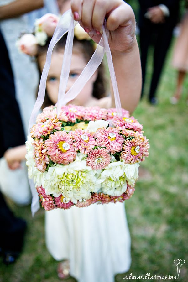 Flower girl purse made of real flowers.
