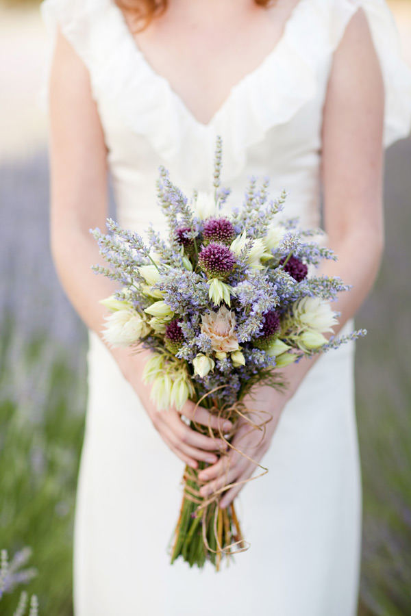 Lavdender brides bouquet with bridal blush protea