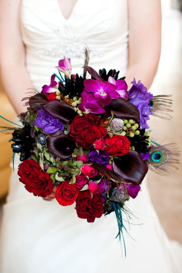 Jewel tone bridal bouquet with peacock feathers