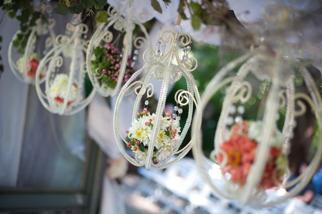Hanging chandeliers filled with flowers