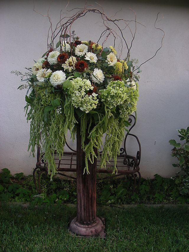 ceremony flowers brown and green twig altar arrangement