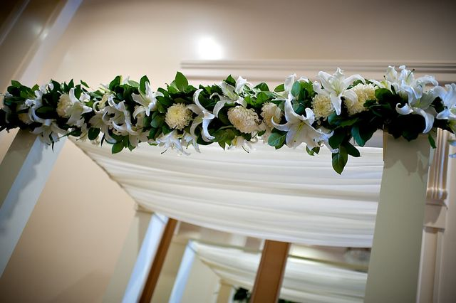 Floral garland detail for the ceremony structure