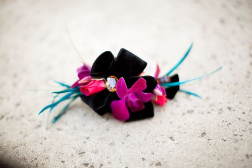 Orchid corsage with black velvet ribbon