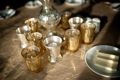 Gold mercury glass votives and silver mint julep cups