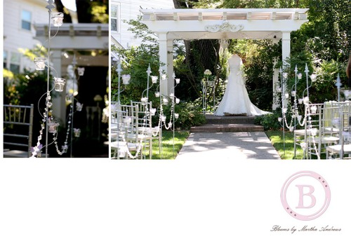 Done with crystal garland down the aisle and votive candle stands that I